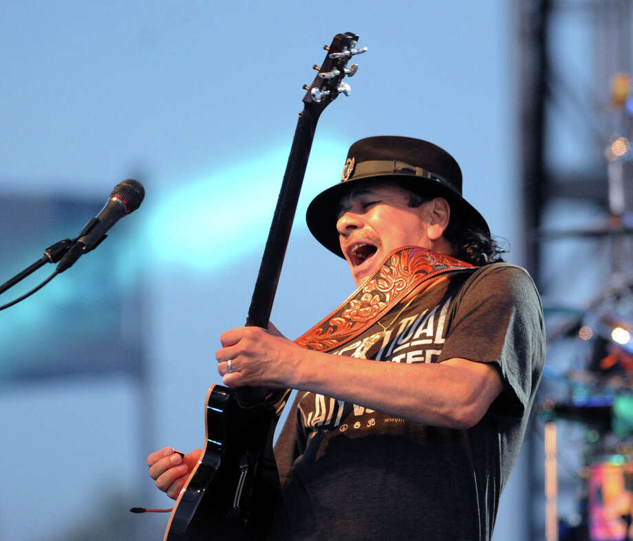 Carlos Santana performs during the Greenwich Town Party at Roger Sherman Baldwin Park, Greenwich, Conn., Saturday, May 24, 2014. Photo: Bob Luckey / Greenwich Time