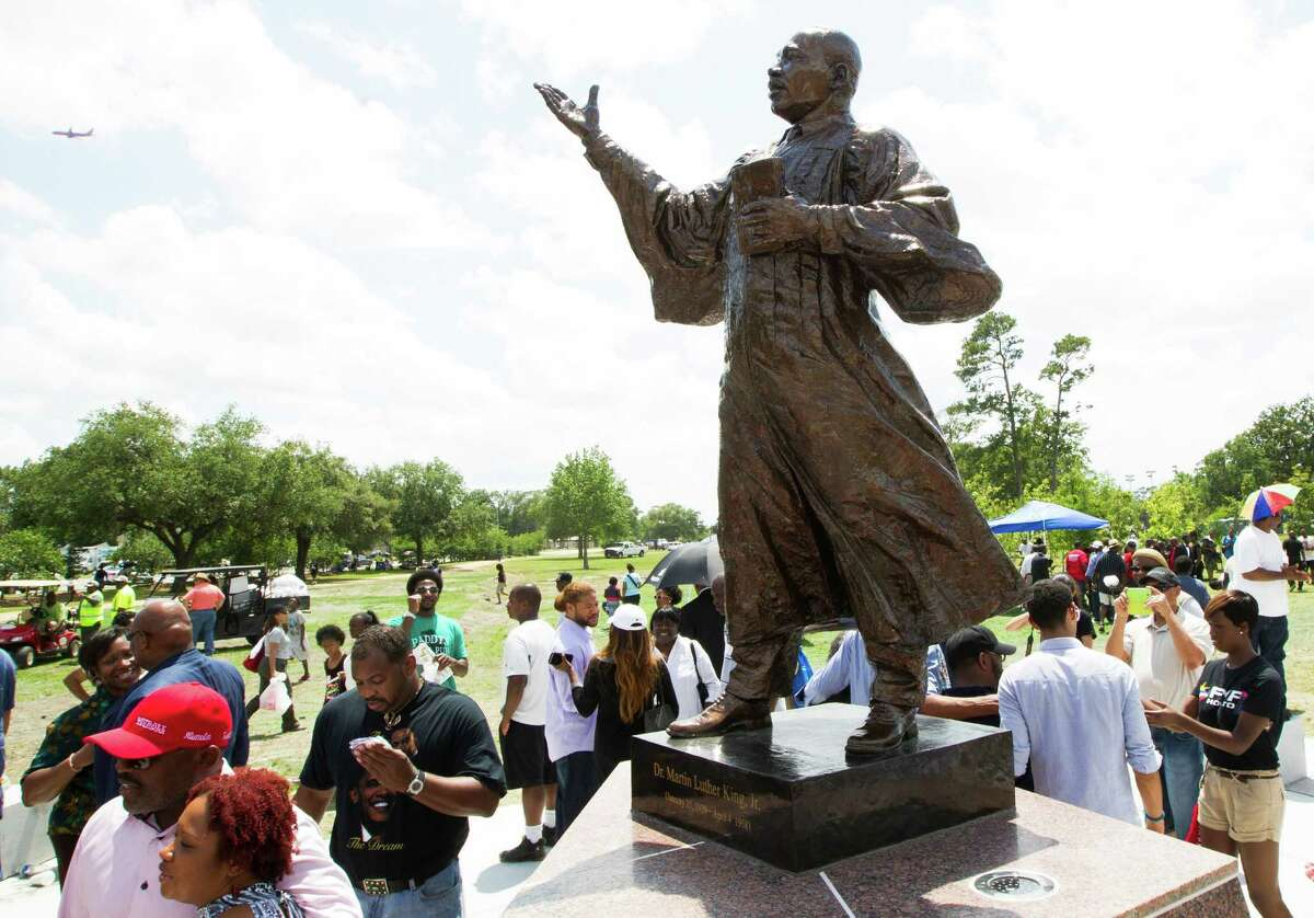 Crowds gather for the unveiling of the new Martin Luther King Jr. statue at MacGregor Park on Saturday, May 24, 2014, in Houston.