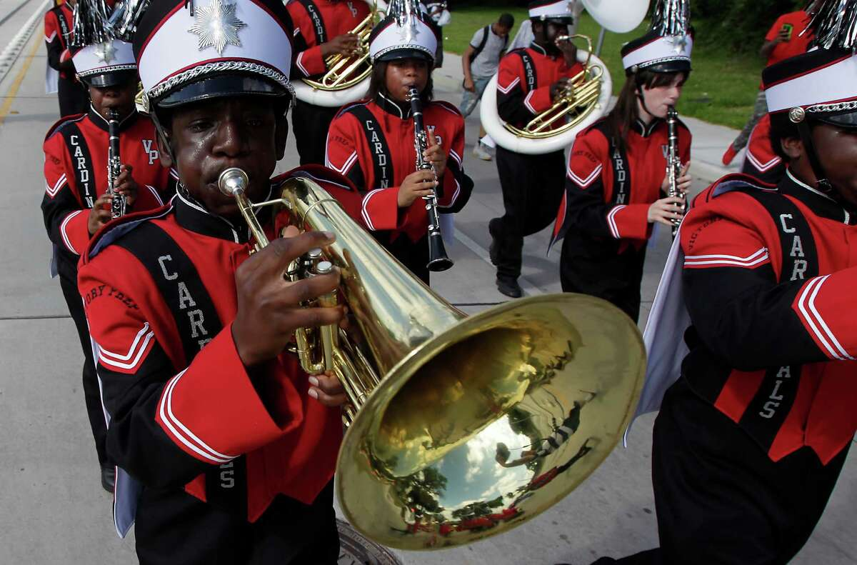 Members of the Victory Preparatory Academy marching band participate in a parade to MacGregor Park for the unveiling of the new Martin Luther King Jr. statue on Saturday, May 24, 2014, in Houston.