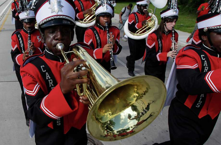 Members of the Victory Preparatory Academy marching band participate in a parade to MacGregor Park for the unveiling of the new Martin Luther King Jr. statue on Saturday, May 24, 2014, in Houston. Photo: J. Patric Schneider, For The Chronicle / © 2014 Houston Chronicle