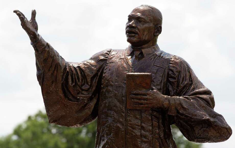 The new Martin Luther King Jr. statue was unveiled at MacGregor Park on Saturday, May 24, 2014, in Houston. Photo: J. Patric Schneider, For The Chronicle / © 2014 Houston Chronicle