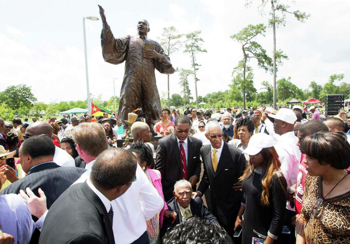 The Black Heritage Society donated a statue of Martin Luther King Jr. to Houston's public art collection. Speakers at the unveiling ceremony Saturday included King's son, Martin Luther King III, and nephew, the Rev. Derek King.