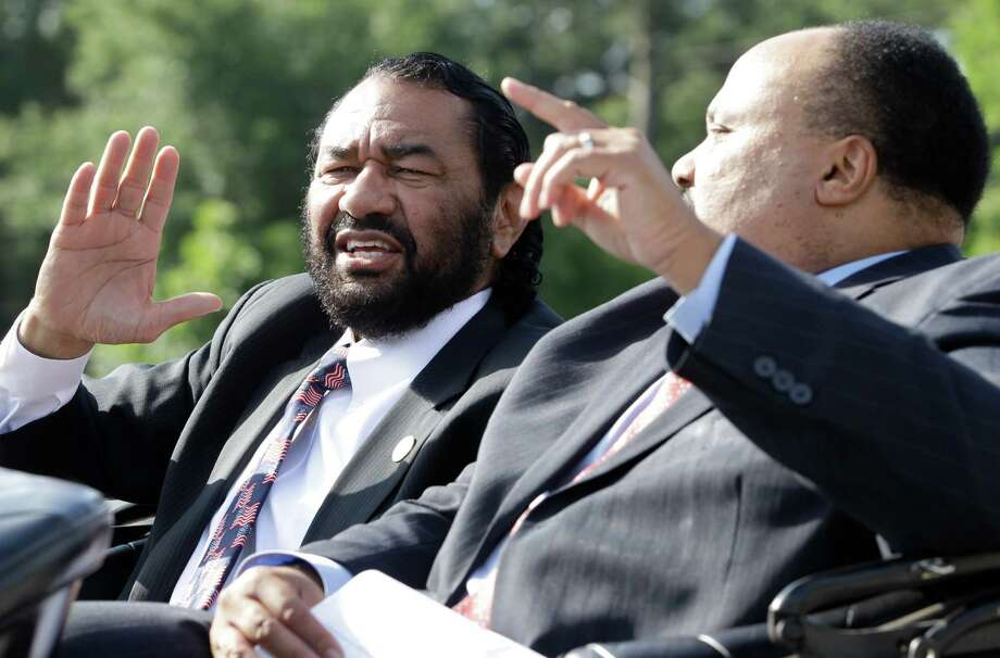 Congressman Al Green and Martin Luther King III wave to the crowd as they participate in a parade to MacGregor Park for the unveiling of the new Martin Luther King Jr. statue on Saturday, May 24, 2014, in Houston. Photo: J. Patric Schneider, For The Chronicle / © 2014 Houston Chronicle