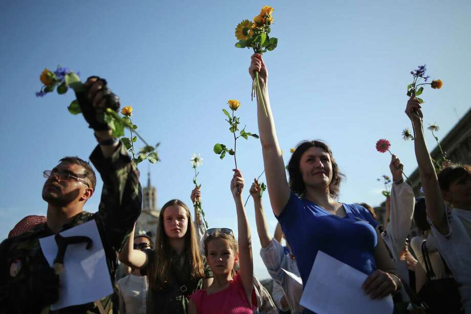 """A """"flash mob"""" sings traditional Ukrainian songs and prays for a peaceful election in Maidan Square in Kiev. Ukraine's presidential election is Sunday. Photo: Dan Kitwood / Getty Images / 2014 Getty Images"""