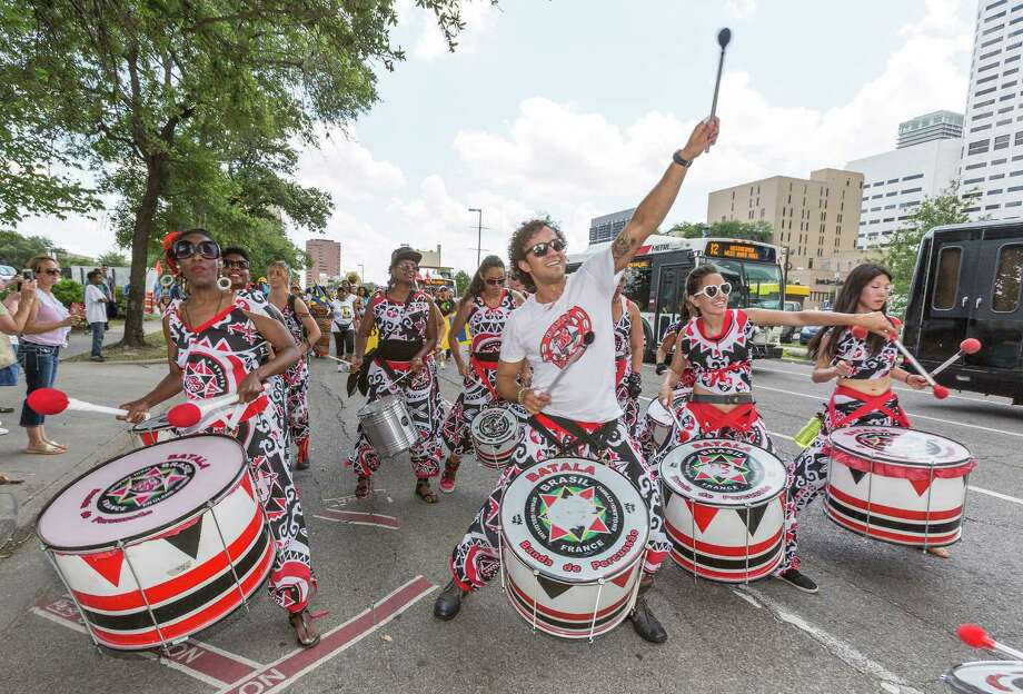 Batala Houston Drummers put on an enthusiastic show for onlookers. Photo: Craig Hartley, For The Chronicle / Copyright: Craig H. Hartley