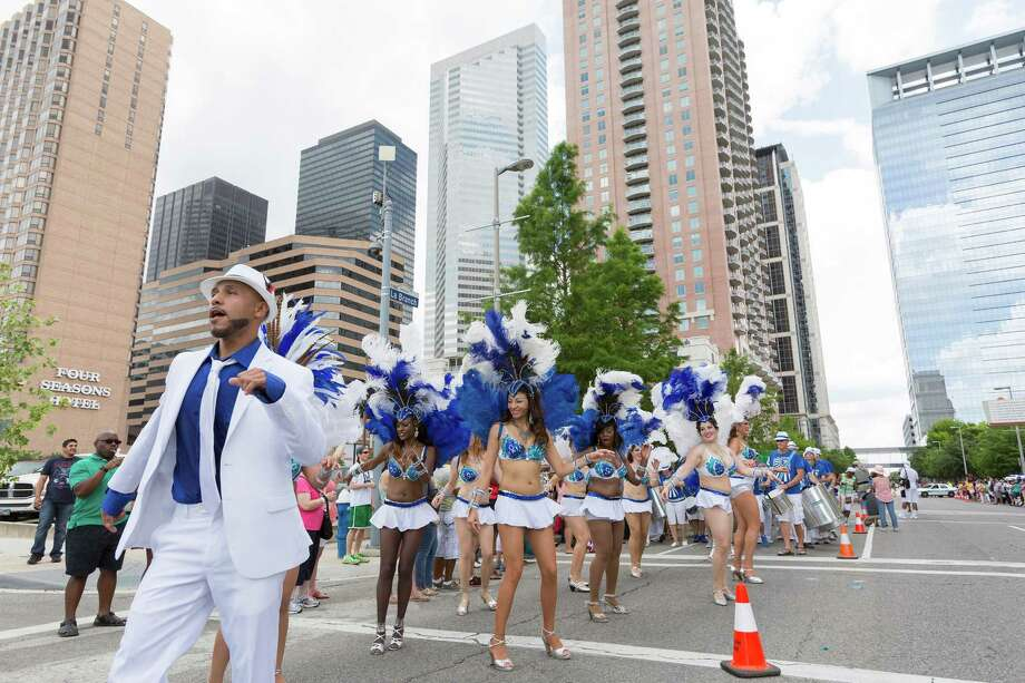 Members of the Austin Samba School perform along the parade route to an appreciative crowd. Photo: Craig Hartley, For The Chronicle / Copyright: Craig H. Hartley