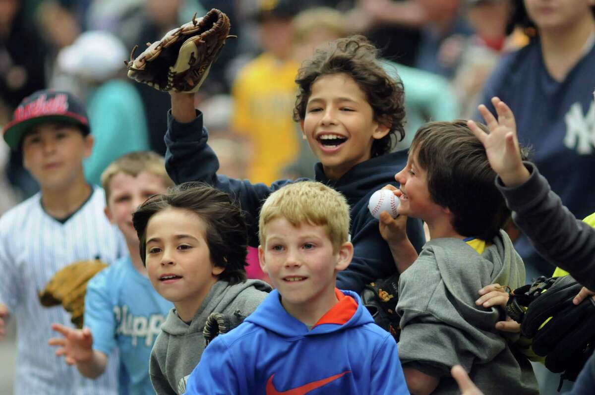 Young baseball fans try to catch tossed balls during the Cooperstown Game Day Parade on Saturday, May 24, 2014, in Cooperstown, N.Y. (Cindy Schultz / Times Union)