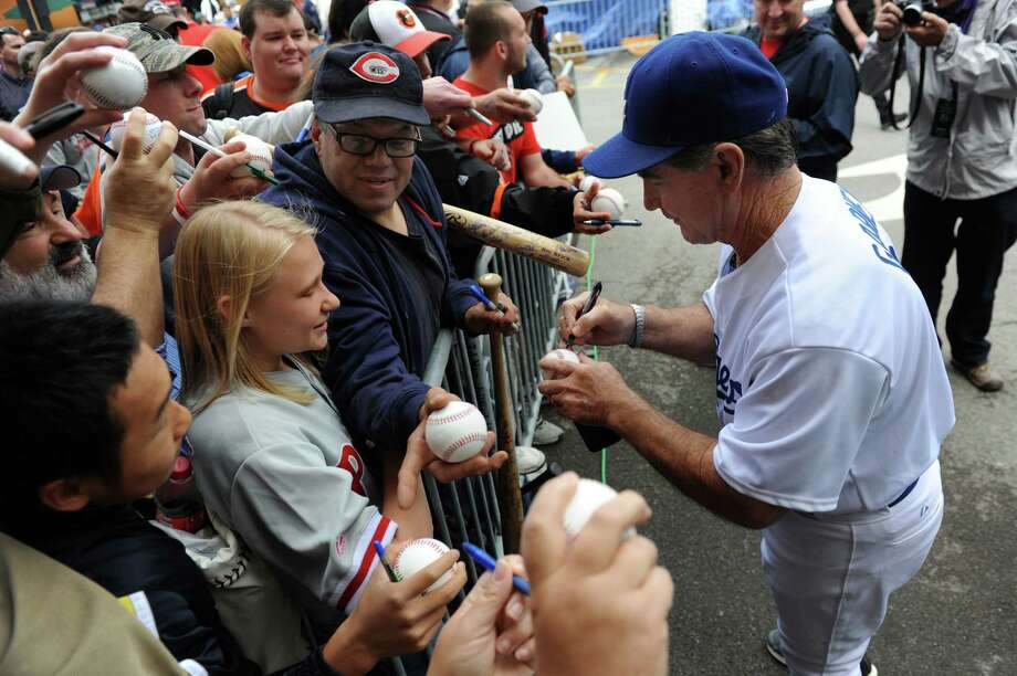 Steve Garvey signs autographs for baseball fans before the sixth annual Hall of Fame Classic baseball game on Saturday, May 24, 2014, at Doubleday Field in Cooperstown, N.Y. (Cindy Schultz / Times Union) Photo: Cindy Schultz / 00027031A