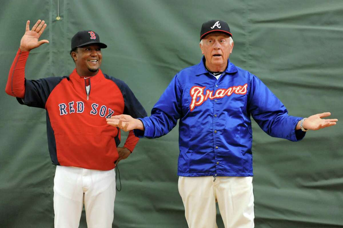American League team manager Phil Niekro, right, announces Pedro Martinez will be the starting pitcher for the sixth annual Hall of Fame Classic baseball game on Saturday, May 24, 2014, at Doubleday Field in Cooperstown, N.Y. (Cindy Schultz / Times Union)