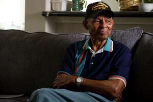 Raymon Lacy, 91, who was a member of the 1949 Houston Eagles, of the Negro Leagues, sits on the couch at his niece's home on Tuesday, May 20, 2014, in Houston.