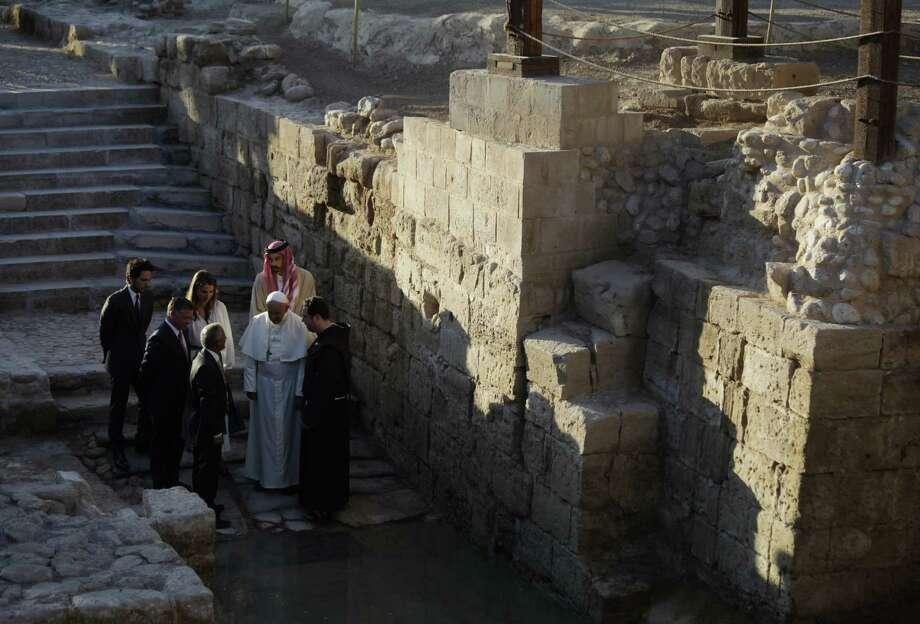 Pope Francis, accompanied by King Abdullah II of Jordan, Queen Rania, Crown Prince Hussein and Prince Ghazi bin Mohammed, visits the Bethany Beyond the Jordan, which is the traditional site of Jesus' baptism. Photo: Mohammad Hannon / Associated Press / AP