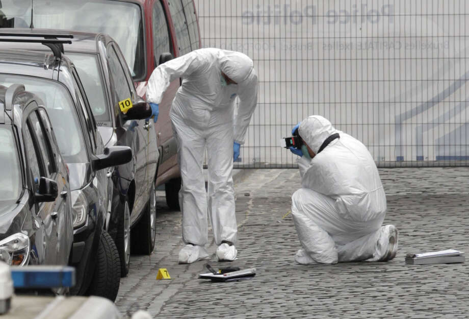 Forensic experts examine the site of a shooting at the Jewish Museum in Brussels. Belgian officials say three people were killed and one person was injured in gunfire at the museum. Photo: Yves Logghe / Associated Press / AP