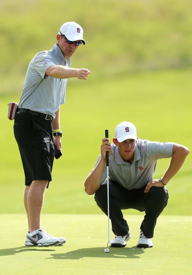 Stanford coach Phil Row (left) helps Patrick Rodgers read a green during the NCAAs. Photo: Travis Morisse, Associated Press