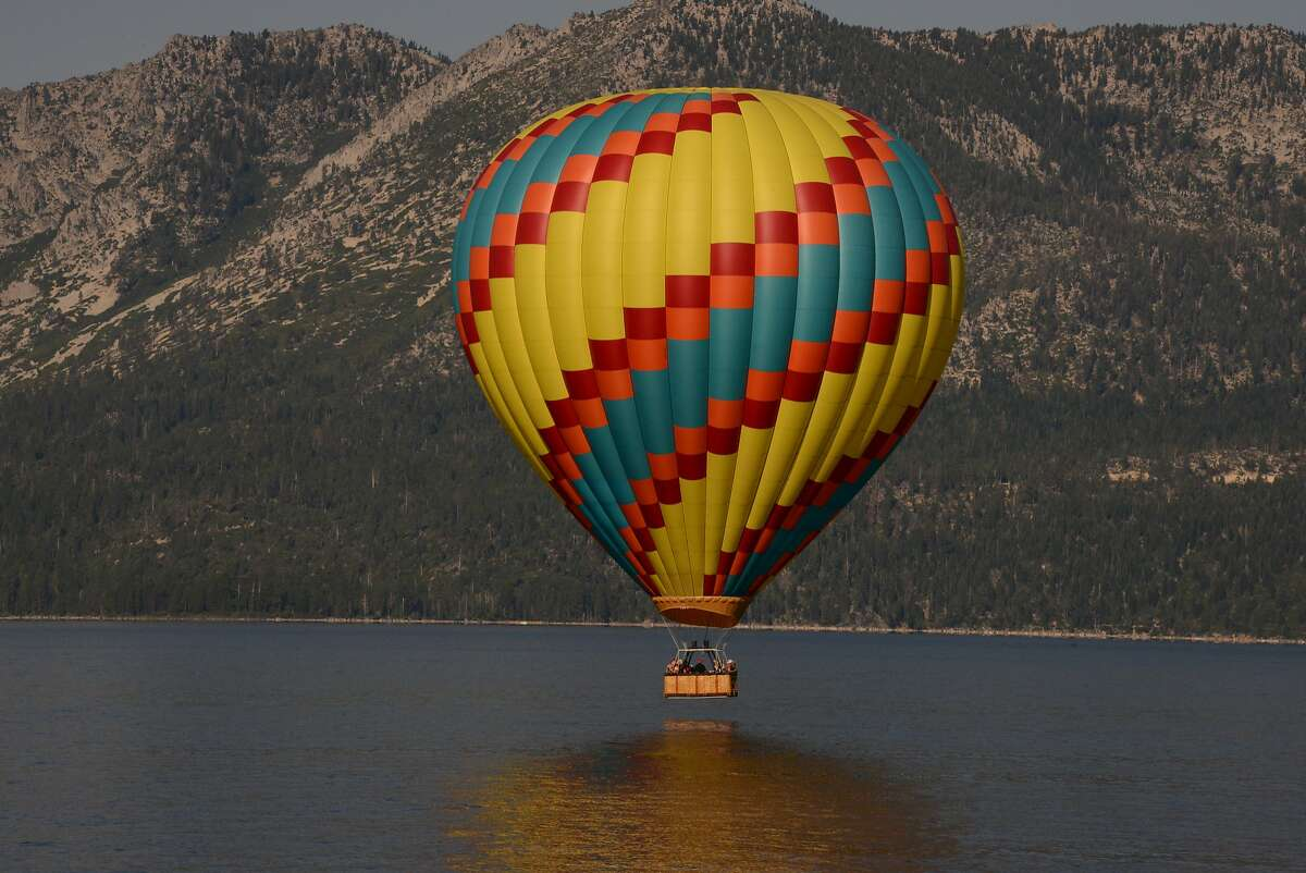 A hot air balloon floats high above Lake Tahoe for the view, but some of the excitement is when you just touch the water.