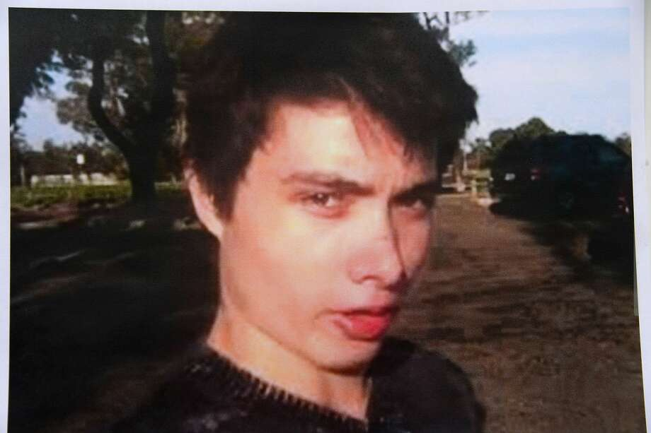 An undated photo of murder suspect Elliot Rodger is seen at a press conference by the Santa Barbara County Sheriff in Goleta, California May 24, 2014.  Rodger, 22, went on a rampage in Isla Vista near the University of California at Santa Barbara campus, stabbed three people to death at his apartment before shooting to death three more in a terrorizing crime spree through the neighborhood. AFP PHOTO / ROBYN BECKROBYN BECK/AFP/Getty Images Photo: Robyn Beck, AFP/Getty Images