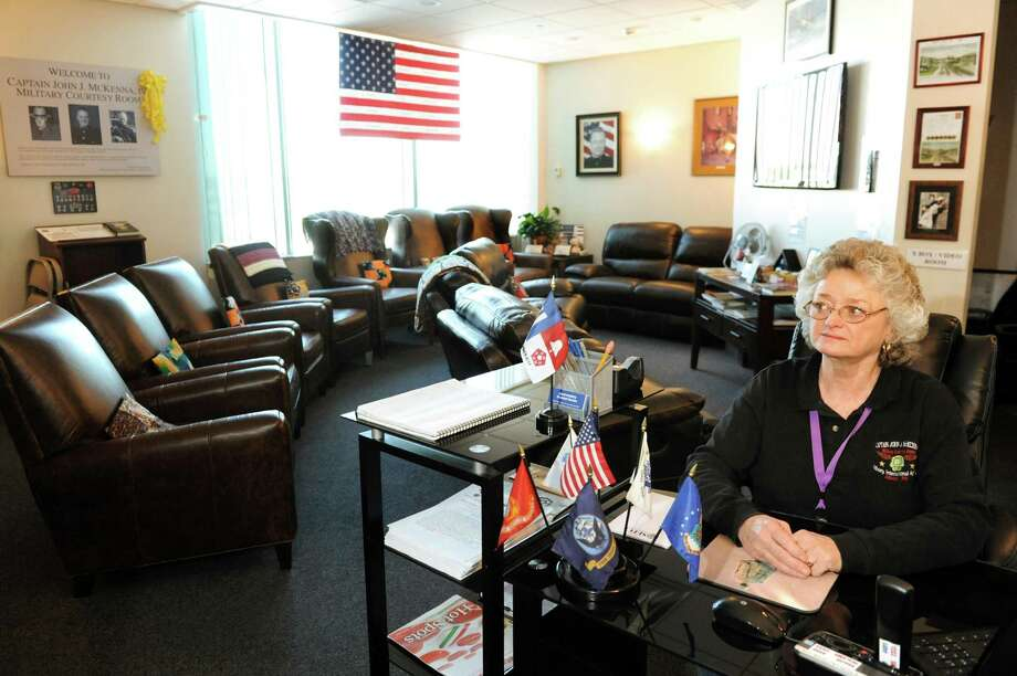Karen McKenna volunteers in the Capt. John J. McKenna IV Military Courtesy Room on Wednesday, May 21, 2014, at the Albany International Airport in Colonie, N.Y. McKenna is the mother of the late John McKenna IV, a Marine and State Trooper who was killed in Fallujah, Iraq on Aug. 16, 2006. (Cindy Schultz / Times Union) Photo: Cindy Schultz / 00026906A