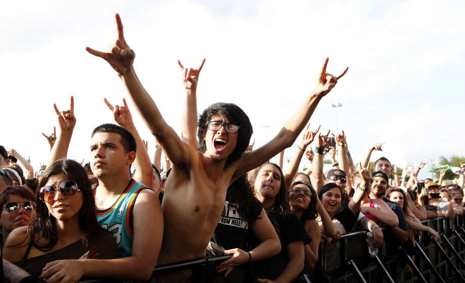 Fans of the Deftones give a shout-out to the band during its performance on the main stage at the Bud Light River City Rockfest outside the AT&T Center. Photo: Photos By Cynthia Esparza / For The San Antonio Expresss-News / SAN ANTONIO EXPRESS-NEWS