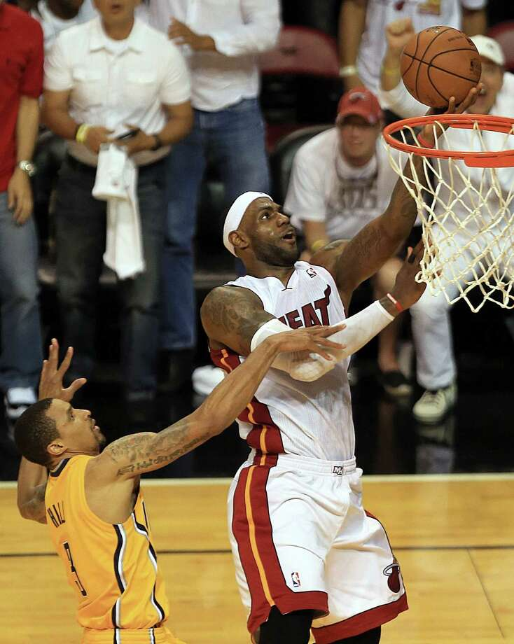 The Heat's LeBron James drives by the Pacers' George Hill to score in the second quarter of Saturday night's Game 3 of the NBA Eastern Conference finals at Miami. Photo: Pedro Portal, MBR / El Nuevo Herald