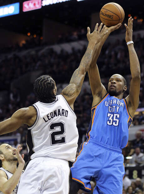 Kevin Durant, shooting over the Spurs' Kawhi Leonard during Game 2, is part of the Thunder elite along with Russell Westbrook and Serge Ibaka. Photo: Edward A. Ornelas / San Antonio Express-News / © 2014 San Antonio Express-News