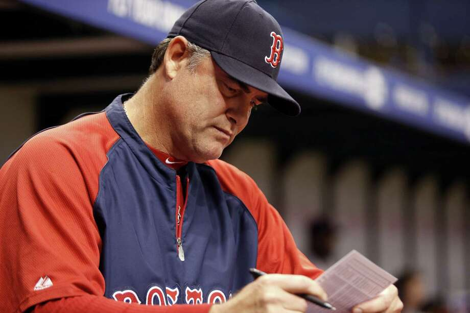 ST. PETERSBURG, FL - MAY 24:  Manager John Farrell #53 of the Boston Red Sox looks over the lineup in the dugout during the ninth inning of a game against the Tampa Bay Rays on May 24, 2014 at Tropicana Field in St. Petersburg, Florida.  (Photo by Brian Blanco/Getty Images) ORG XMIT: 477583645 Photo: Brian Blanco / 2014 Getty Images