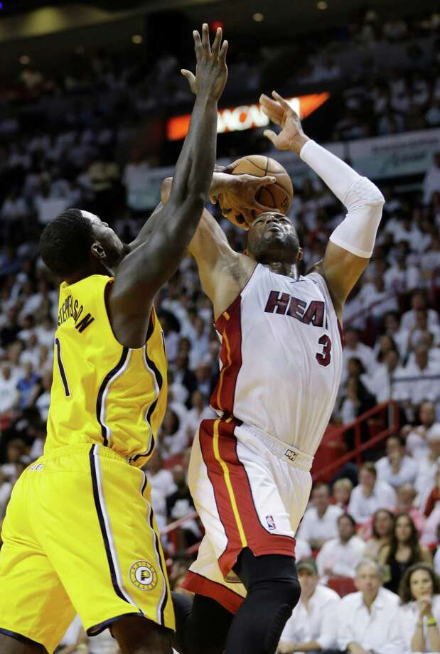 Miami Heat guard Dwyane Wade (3) drives to the basket as Indiana Pacers guard Lance Stephenson defends during the second half of Game 3 in the NBA basketball Eastern Conference finals playoff series, Saturday, May 24, 2014, in Miami. (AP Photo/Lynne Sladky) ORG XMIT: AAA130 Photo: Lynne Sladky / AP