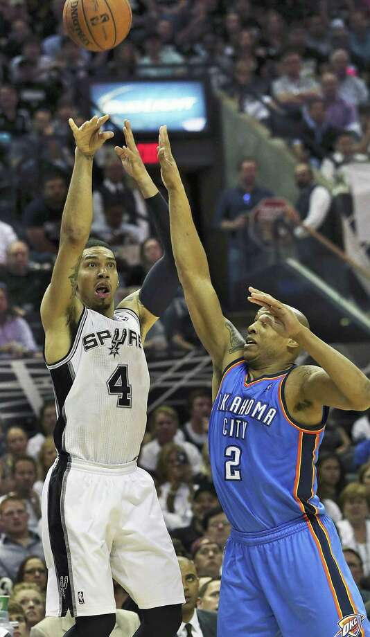 "Danny Green, shooting a three against Caron Butler in Game 2, went from the D-League to one of the best playoff shooters in Spurs history. ""He's come a long way,"" Gregg Popovich said. Photo: Tom Reel / San Antonio Express-News"