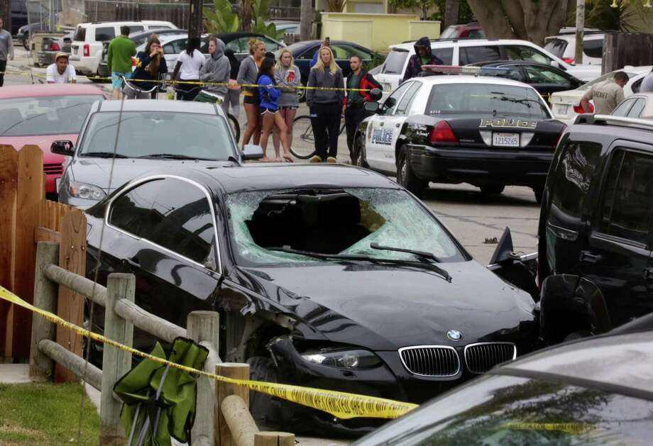 Elliot Rodger's crashed BMW sits in Isla Vista, Calif., the day after his killing spree, in which he stabbed three people to death and gunned down three more. Police believe that he also killed himself. Photo: Irfan Khan / Los Angeles Times / Los Angeles Times