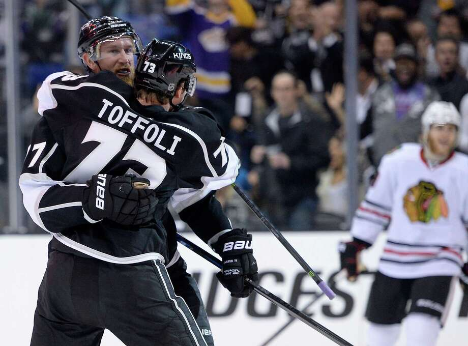 Jeff Carter and Tyler Toffoli of the Kings congratulate each other during their 4-3 win over the Blackhawks on Saturday. Photo: Harry How / Getty Images / 2014 Getty Images