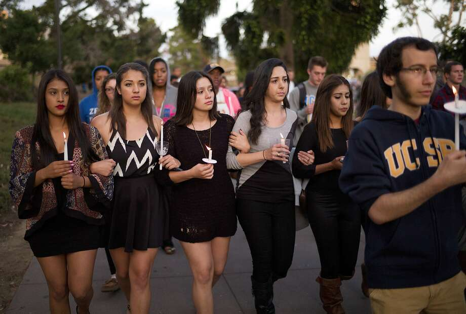 Students march on the campus of UC Santa Barbara during a candlelight vigil held to honor the victims of Friday night's mass shooting and stabbings that left seven dead in Isla Vista. Photo: Jae C. Hong, Associated Press