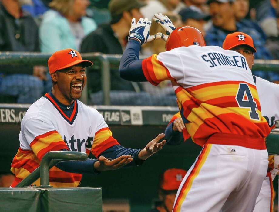 Astros manager Bo Porter, left, is loving it as George Springer works the receiving line after slugging a home run in the fifth inning at Seattle on Saturday night. It was Springer's second two-run shot of the game. Photo: Otto Greule Jr, Getty Images / 2014 Getty Images