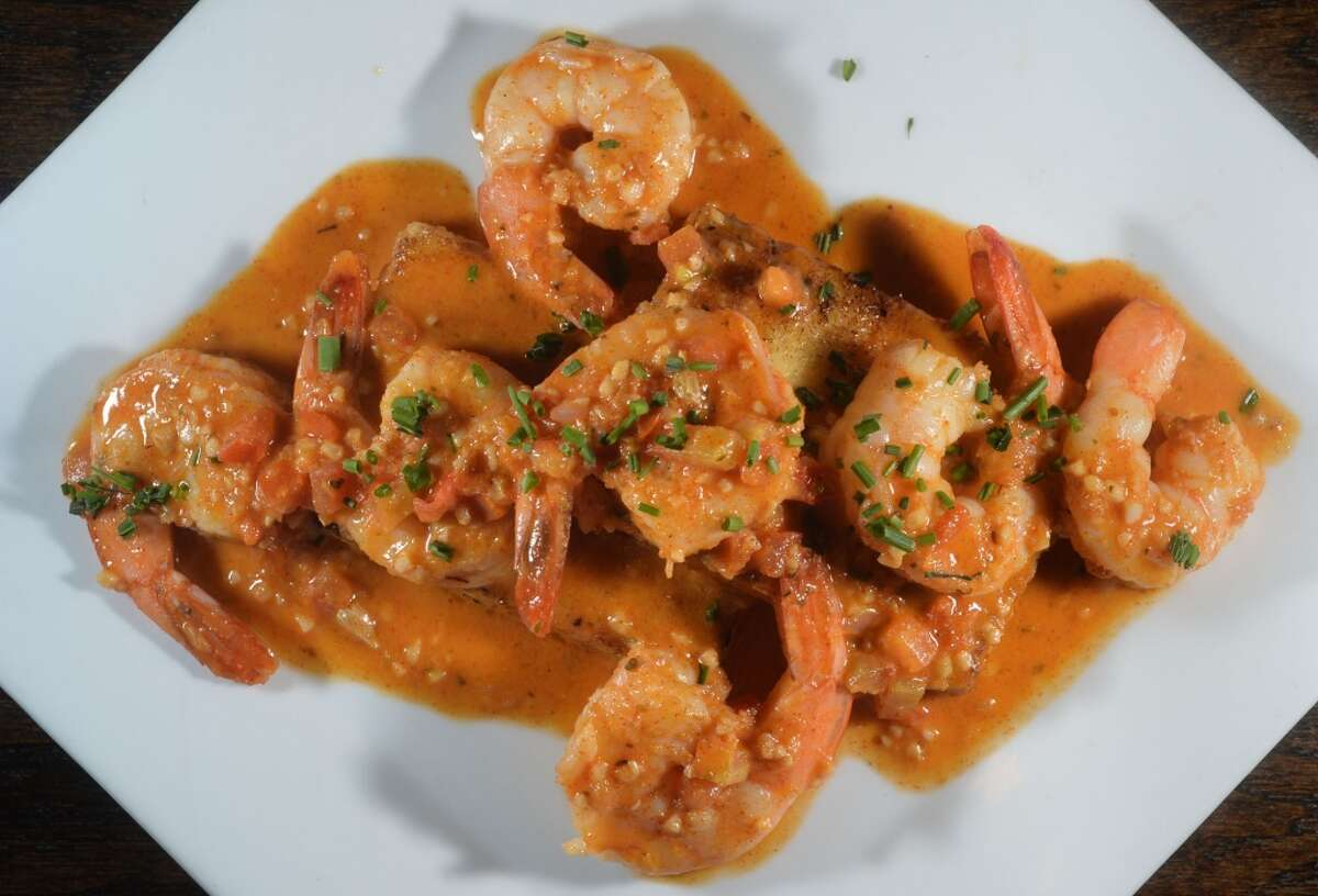 Shrimp and grits topped with a tomato based cream sauce at the Neches River Wheelhouse in Port Neches. Photo taken Tuesday, May 13, 2014 Guiseppe Barranco/@spotnewsshooter