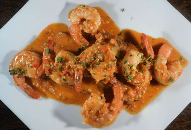 Shrimp and grits topped with a tomato based cream sauce at the Neches ...