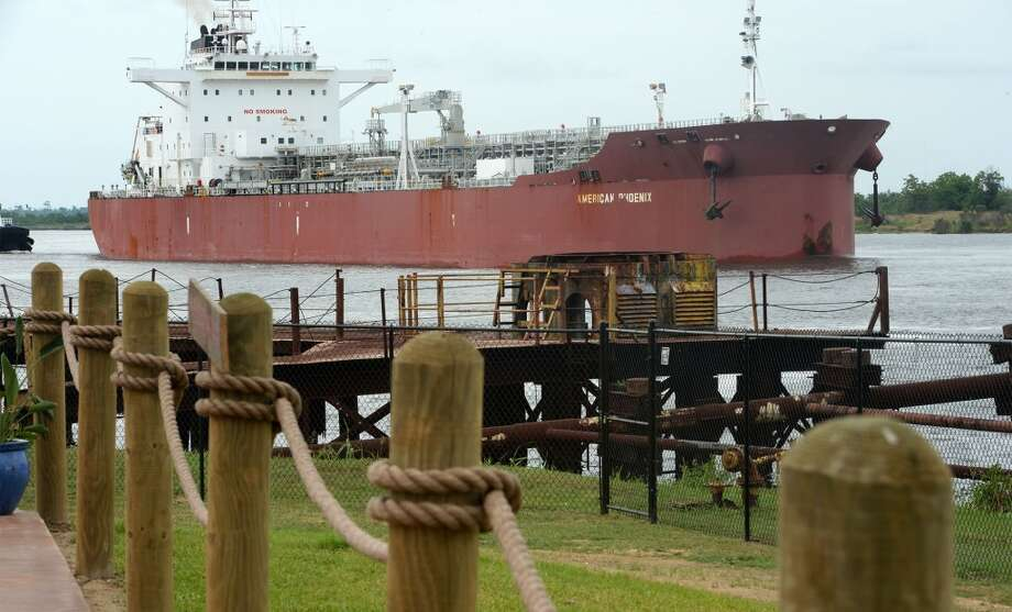 A tanker ship passes the Neches River Wheelhouse in Port Neches. Photo taken Tuesday, May 13, 2014 Guiseppe Barranco/@spotnewsshooter