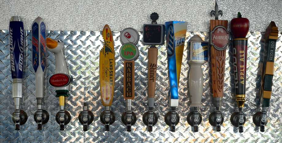 Beer taps at the Neches River Wheelhouse in Port Neches. Photo taken Tuesday, May 13, 2014 Guiseppe Barranco/@spotnewsshooter