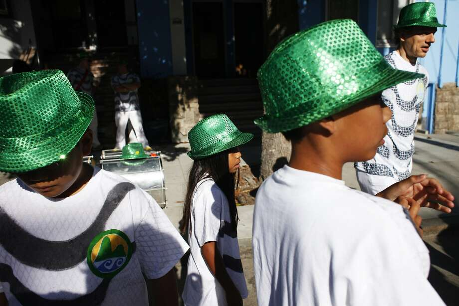 Members of Grupo Samba Rio hang out on Bryant Street before a Carnaval celebration on May 25, 2014 in San Francisco, Calif. The 36th Annual Carnaval San Francisco parade began on 24th Street, turned onto Mission, and concluded on 17th Street. Photo: Pete Kiehart, The Chronicle