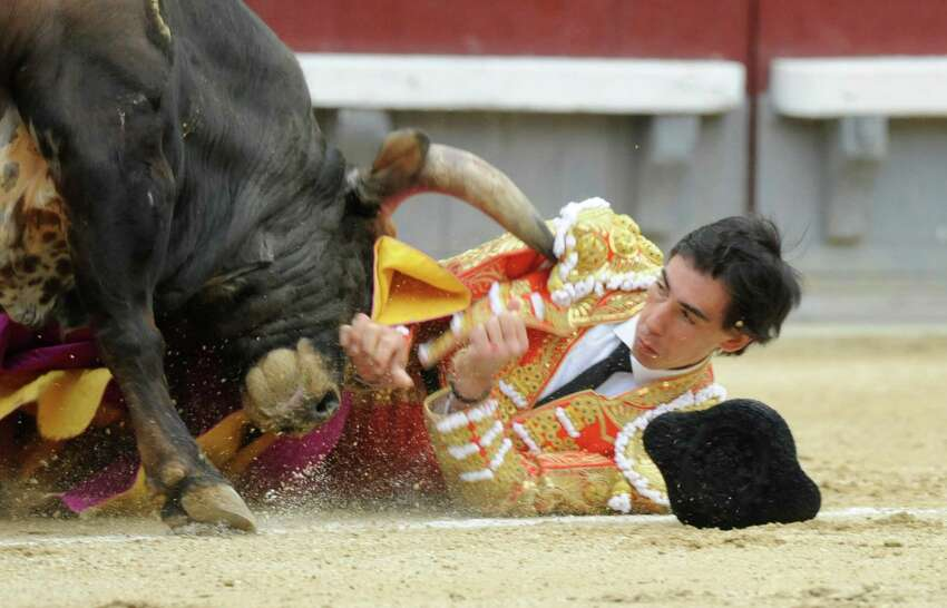 Spanish matador Saul Jimenez Fortes is gored by a bull during the San Isidro Fair at Las Ventas bullring on May 20, 2014 in Madrid, Spain. For the first time since 1979, the bullfight was cancelled after the three bullfighters were injured by bulls. (Photo by Europa Press/Europa Press via Getty Images)