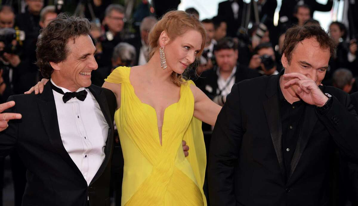 """(L to R) US producer Lawrence Bender, US actress Uma Thurman and US director Quentin Tarantino attend """"Sils Maria"""" (Clouds of Sils Maria) film screening in competition during the 67th Cannes Film Festival in Cannes, France. May 23, 2014. (Photo by Mustafa Yalcin/Anadolu Agency/Getty Images)Related stories: Turkish drama 'Winter Sleep' wins Palme d'Or PHOTO GALLERY: Cannes' fashion highs"""