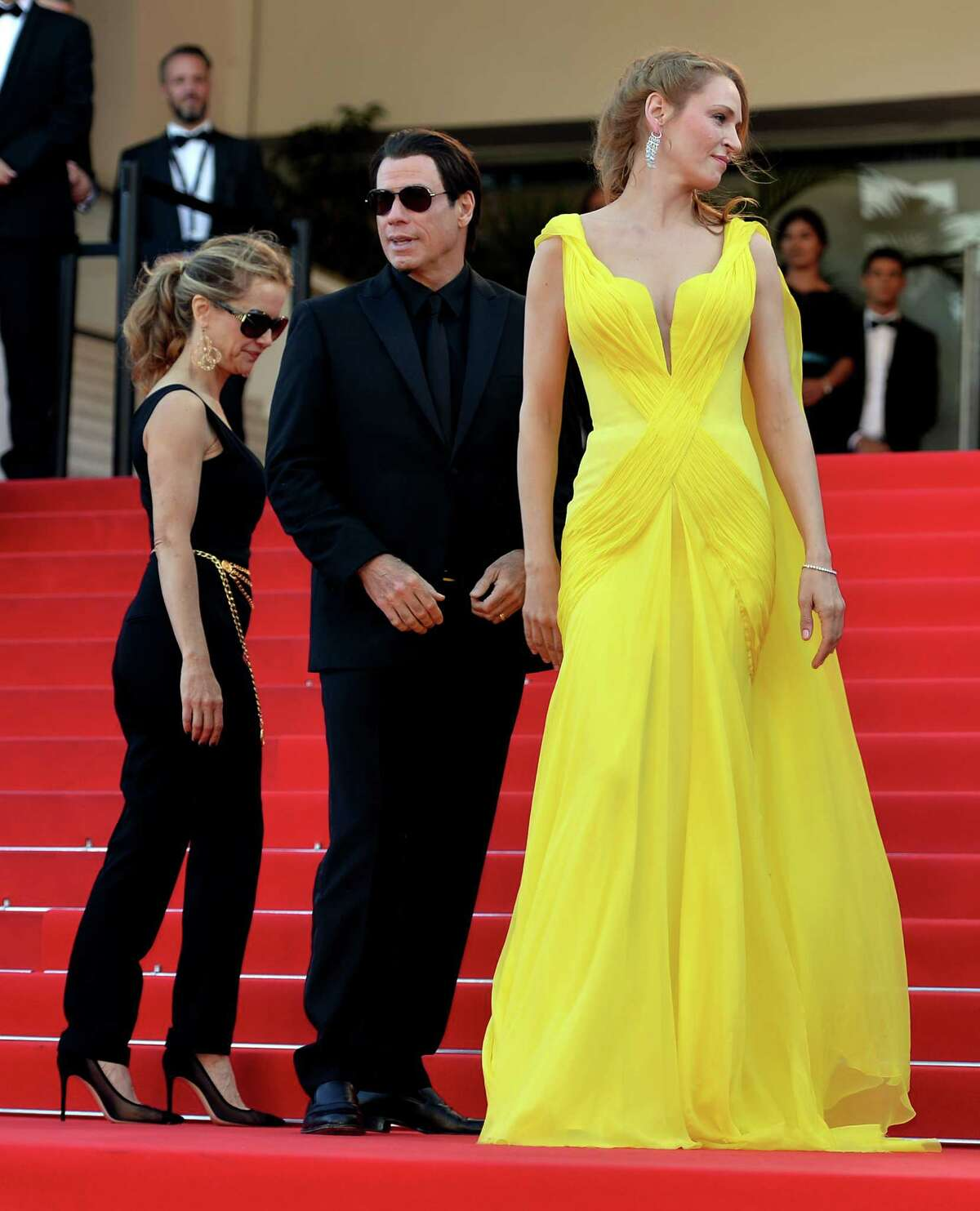 """(L to R) US actress Kelly Preston, US actor John Travolta and US actress Uma Thurman attend """"Sils Maria"""" (Clouds of Sils Maria) film screening in competition during the 67th Cannes Film Festival in Cannes, France. May 23, 2014. (Photo by Mustafa Yalcin/Anadolu Agency/Getty Images)Related stories: Turkish drama 'Winter Sleep' wins Palme d'Or PHOTO GALLERY: Cannes' fashion highs"""