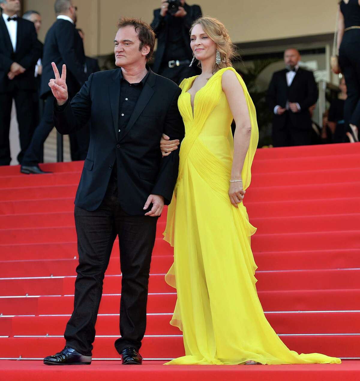 """Director Quentin Tarantino (L) and actress Uma Thurman (R) attend """"Sils Maria"""" (Clouds of Sils Maria) film screening in competition during the 67th Cannes Film Festival in Cannes, France. May 23, 2014. (Photo by Mustafa Yalcin/Anadolu Agency/Getty Images)Related stories: Turkish drama 'Winter Sleep' wins Palme d'Or PHOTO GALLERY: Cannes' fashion highs"""
