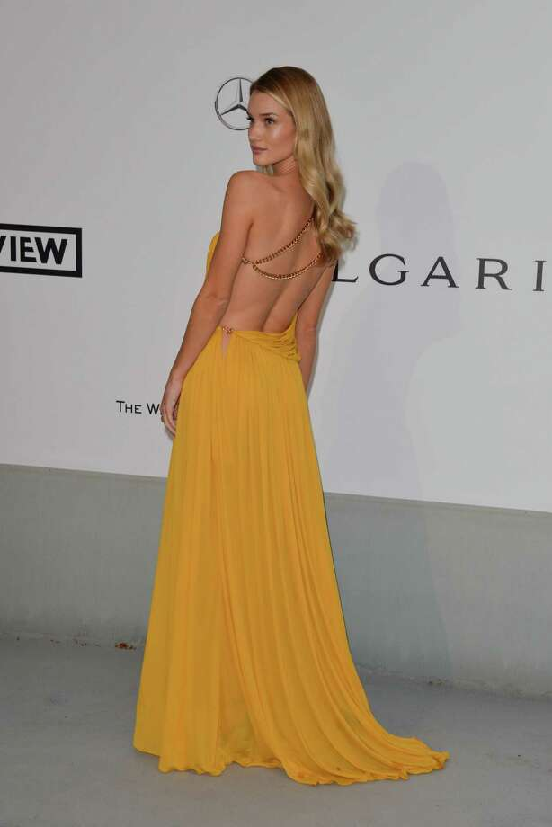 Rosie Huntington-Whiteley attends amfAR's 21st Cinema Against AIDS Gala, Presented By WORLDVIEW, BOLD FILMS, And BVLGARI at the 67th Annual Cannes Film Festival on May 22, 2014 in Cap d'Antibes, France.  (Photo by George Pimentel/WireImage) Photo: George Pimentel, Getty Images  / 2014 George Pimentel
