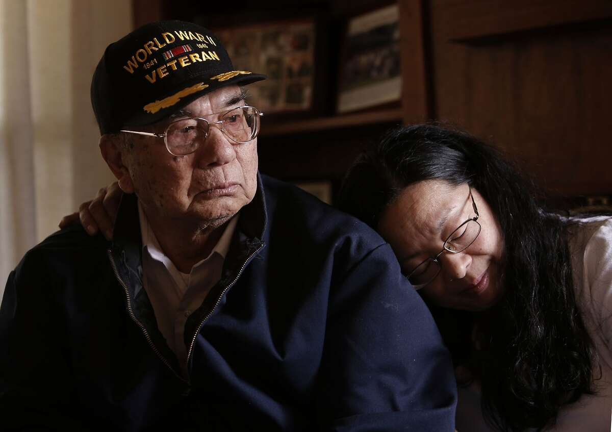Pedro Pineda, a survivor of the Bataan Death March of 1942, is comforted by his daughter Evelyn Bramlette as he recalls the memories of the march on Thursday May 22, 2014, in San Francisco, Calif. A talk with survivors of the Bataan Death March.