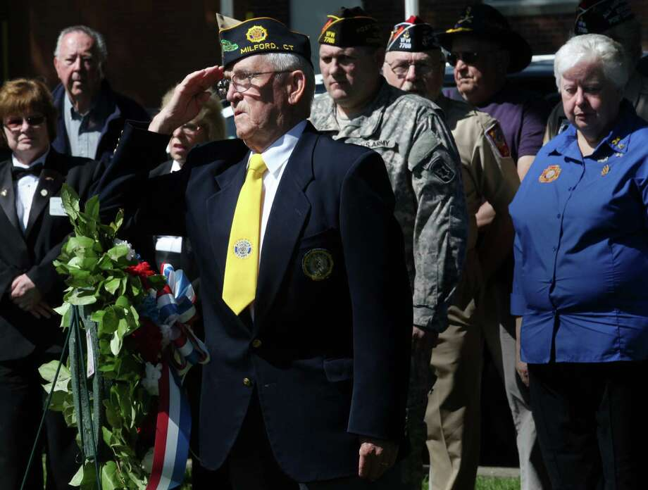 Veteran Wayne Carson, of American Legion Post 34,  salutes after presenting a wreath during the City of Milford's annual Memorial Day Wreath Laying Ceremony on Sunday, May 25th, 2014. Photo: BK Angeletti, B.K. Angeletti / Connecticut Post freelance B.K. Angeletti
