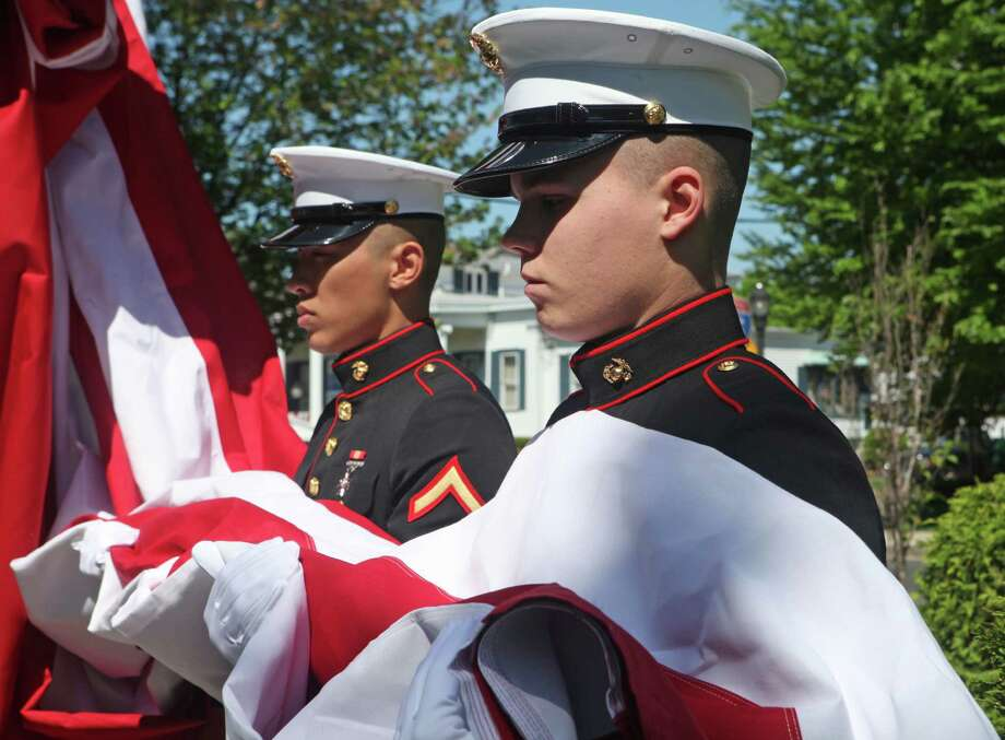 Marines,  PFC Fan Jiawei, of Milford, left, and PFC Phillip Weisgaele, of Stratford, hold the flag during a ceremony to dedicate a new flagpole on the Milford green on Memorial Day, Sunday, May 25th. The Devon Rotary gifted the flagpole. The flagpole is the largest in Connecticut. Photo: BK Angeletti, B.K. Angeletti / Connecticut Post freelance B.K. Angeletti