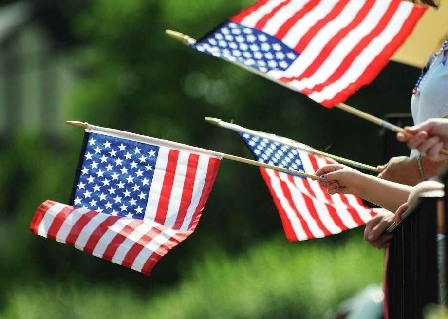 99010 RIDGEWOOD 07/04/12  American flags are waved during the July 4th Independent Day parade in Ridgewood.   Mitsu YASUKAWA/ Staff Photographer Photo: Mitsu Yasukawa / Staff Photograp / 2012 North Jersey Media Group