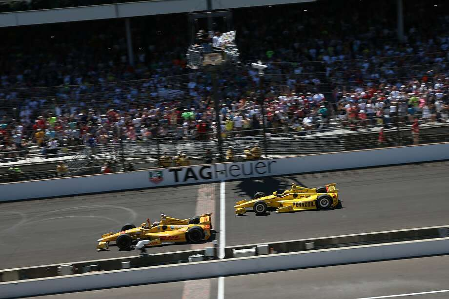 It was that close at Indy, with Ryan Hunter-Reay crossing the yard of bricks ahead of Helio Castroneves. Photo: Chris Graythen, Getty Images