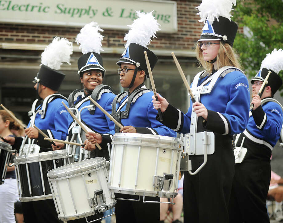 The Ansonia High School Charger marching band performs in the Memorial Day Parade on Main Street in Ansonia, Conn. on Sunday, May 25, 2014. Photo: Brian A. Pounds / Connecticut Post