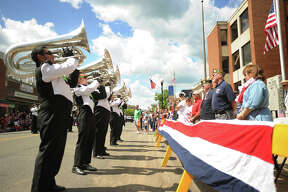The Connecticut Hurricanes marching band performs to the reviewing stand in front of Ansonia City Hall during the Memorial Day Parade on Main Street in Ansonia, Conn. on Sunday, May 25, 2014.