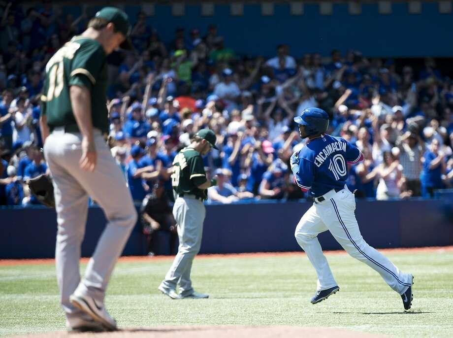 Edwin Encarnacion (right) homers in the fourth inning, snapping Drew Pomeranz's 18-inning scoreless streak. Photo: Nathan Denette, Associated Press