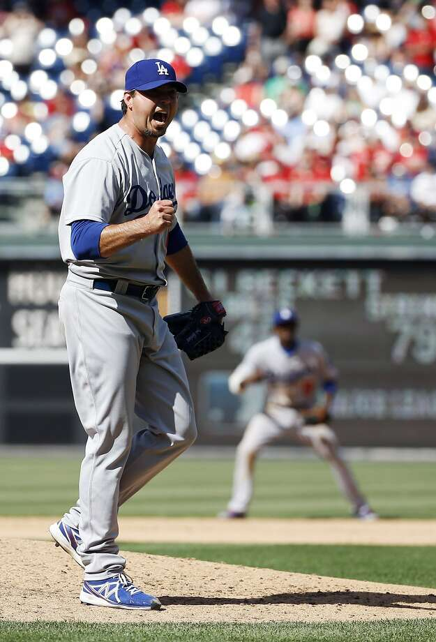 Los Angeles Dodgers starting pitcher Josh Beckett reacts after striking out Philadelphia Phillies' Chase Utley looking for a no-hitter baseball game, Sunday, May 25, 2014, in Philadelphia. Los Angeles won 6-0. (AP Photo/Matt Slocum) Photo: Matt Slocum, Associated Press