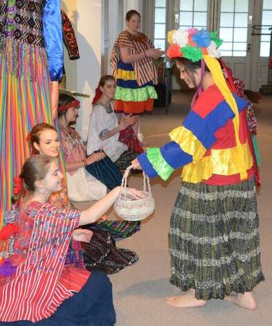 On May 2, the National Museum of Dance in Saratoga Springs held the opening reception for one of its newest exhibits: Tradition in Movement: Dance Culture of Guatemala. About 200 people attended. The exhibit will run through April 2015. Among those participating in the reception was Valerie Nguyen, holding the basket. Photo: Picasa